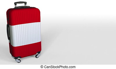 Traveler's suitcase featuring flag of Peru. Peruvian tourism...