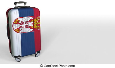 Traveler's suitcase featuring flag of Serbia. Serbian...