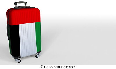 Traveler's suitcase featuring flag of the United Arab Emirates. UAE tourism conceptual animation, blank space for caption