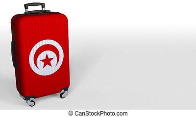 Traveler's suitcase featuring flag of Tunisia. Tunisian...