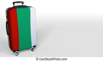 Traveler's suitcase with flag of Bulgaria. Bulgarian tourism...