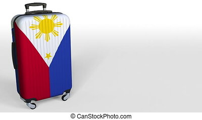 Traveler's suitcase with flag of Philippines. Tourism...
