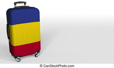 Traveler's suitcase with flag of Romania. Romanian tourism...
