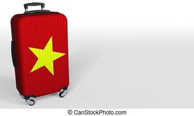 Traveler's suitcase with flag of Vietnam. Vietnamese tourism...