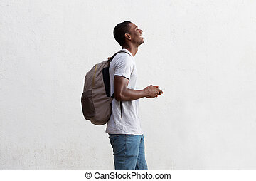 Traveling african american man holding cell phone