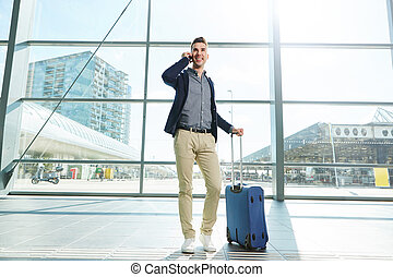 Traveling businessman on the airport
