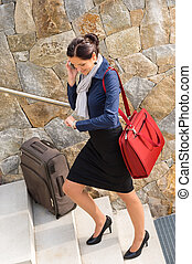 Traveling businesswoman hurried rushing climbing baggage carry-on shoulder bag