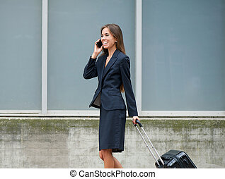 Traveling businesswoman on mobile phone