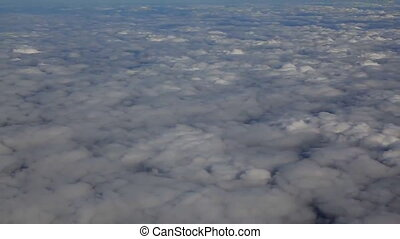 Traveling by air above clouds. View through an airplane window. Flying over the Mediterranean
