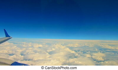 Traveling by air. View through an airplane window,...