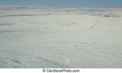 Traveling by air. View through an airplane window. Full high...