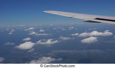 Traveling by air. View through an airplane