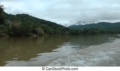 Traveling by boat down the river