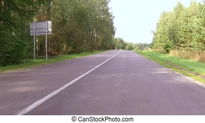 Traveling by car on smooth paved road