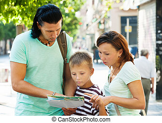 Traveling family  looking at the map