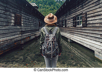 Traveling girl with a backpack