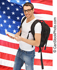 traveling student with backpack and book over American flag