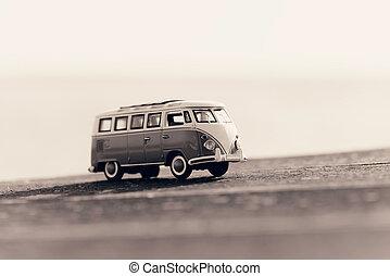 Traveling vintage camper van. Macro photo. Sepia toned image
