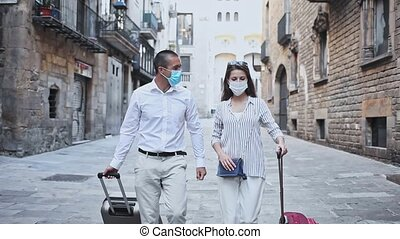 Traveling young spouses wearing medical masks to prevent ...