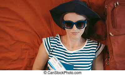 Traveller Lies on Bed - Relaxed and happy traveller with...