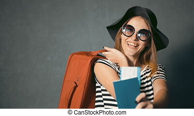 Traveller Shows Passport and Ticket - Smiling traveller with...