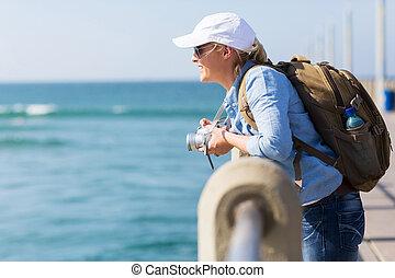 traveller standing on pier - pretty female traveller...