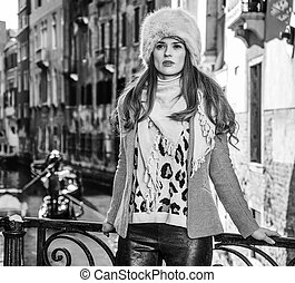 traveller woman in Venice, Italy looking into the distance