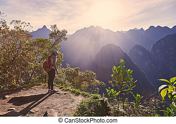 Traveller woman stand on mountain cliff