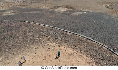 Travellers hike in the Israeli Negev Desert - HaMinsara...