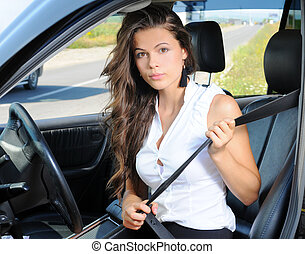 Travelling - An attractive young Caucasian woman fastening...