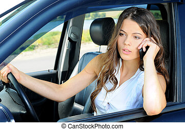 Travelling - An attractive young Caucasian woman talking on...