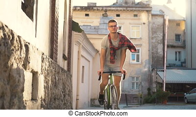 Travelling by Bike - Boy in gray t-shirt and denim shorts...