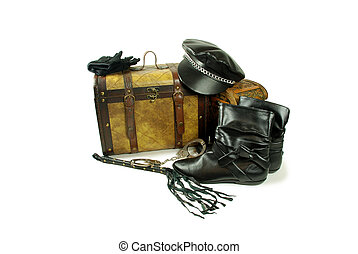 A pair of old cases for storing items, Leather biker cap with a chain across the bill, Whip made of woven leather, White gloves with textured bumps for gripping, Black leather boots to be worn on the feet