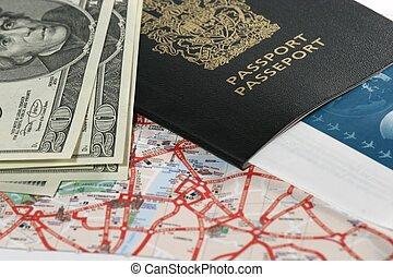 Closeup of map, US dollar bills, passport and ticket