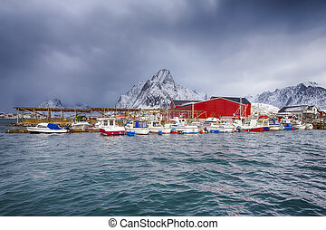 Travelling Concepts. Line of Traditional Norwegian Houses and Fishing Boats at Reine Village on Lofoten Islands.