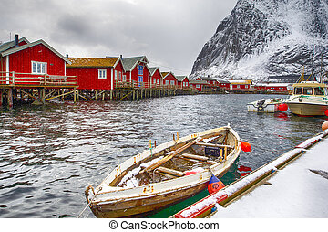 Travelling Concepts. Line of Traditional Norwegian Houses and Fishing Boats at Reine Village on Lofoten Islands