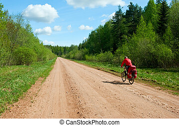 Travelling cyclist - Traveling cyclist on dirt road