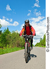 Travelling cyclist - Traveling cyclists on country road