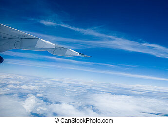 Travelling - high in the clouds in a plane