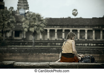 Travelling in Siem Reap - Lady tourist resting at Angkor Wat