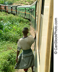 travelling - Man hanging outside the train (Madagascar).