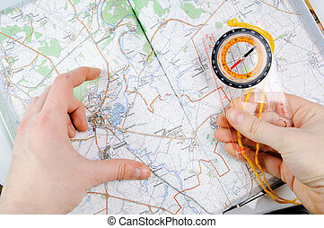 Travelling - Concept with map, compass and human hands