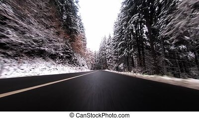 Travelling scenic winter road by car