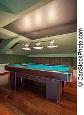 Travertine house - modern attic with gameplace