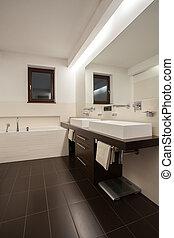 Travertine house - beige bathroom