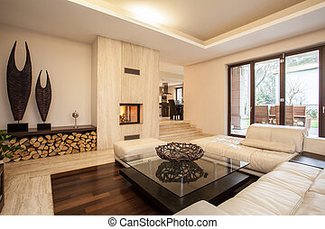 Travertine house: Interior of beige living room