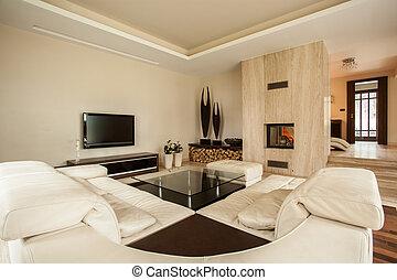 Travertine house: designer living room