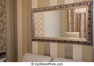 Travertine house - golden mirror