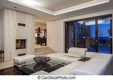 Travertine house - living room and view of dining room