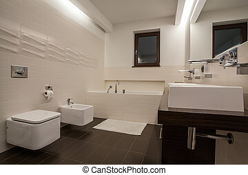 Travertine house - well-designed bathroom